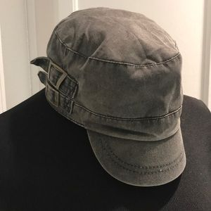 Short bill hat with side buckles